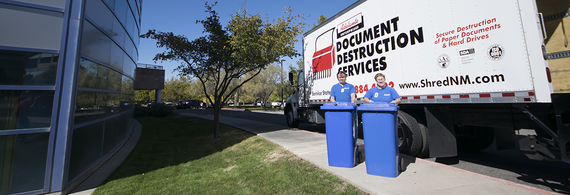 Adelante Document Destruction Services team at a customer location picking up documents to shred